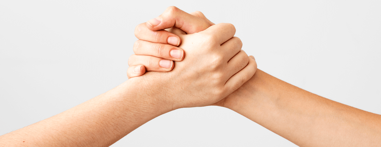 Two hands holding onto each other