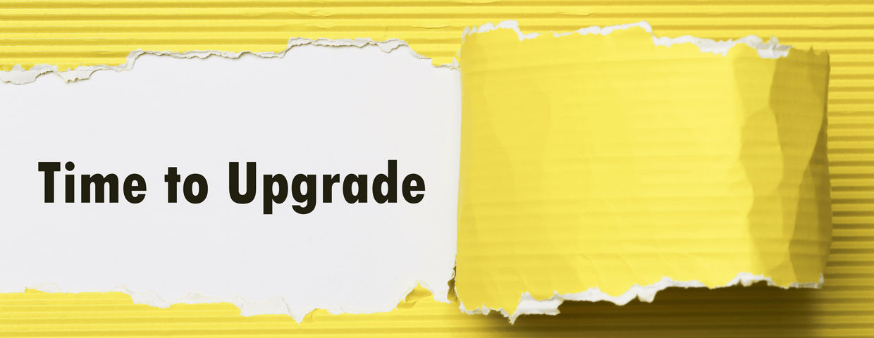 Time to upgrade written under torn yellow paper