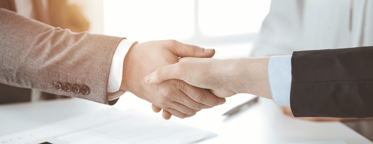 Two business employees shaking hands.